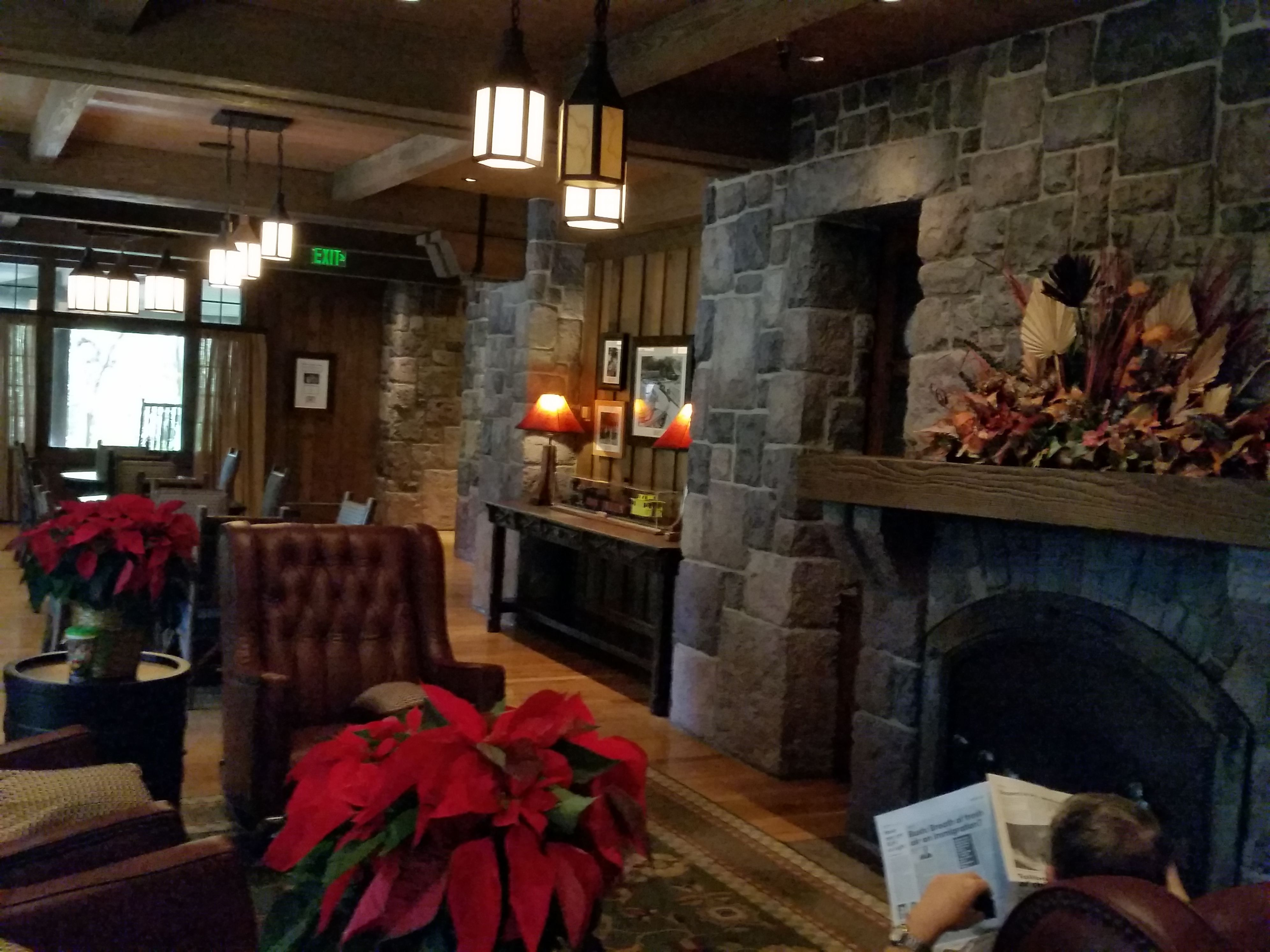 The Carolwood Pacific Room's fireplace and leather rockers at the DVC Villas at Wilderness Lodge. Rustic luxury! http://www.allears.net | #DVC #WDW #WaltDisneyWorld #LuxuryResorts #DisneyVacationClub #Holidays