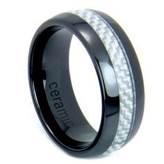 8mm black high tech ceramic wedding band with real light gray carbo fiber strip going through the center of the ring. This ring is very durable and comfortable!