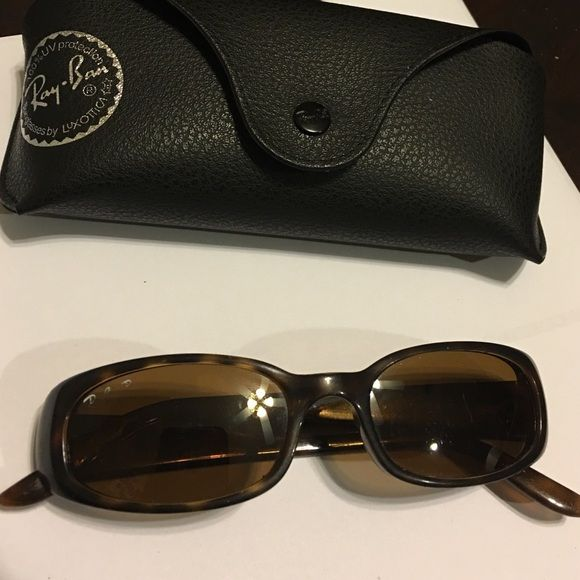 """Ray-ban sunglass with case Great used and cute sunglass that has tiny unnoticeable scratches on the lens and the word""""Ray-ban""""on the lens faded but overall looks good. Ray-Ban Accessories Glasses"""
