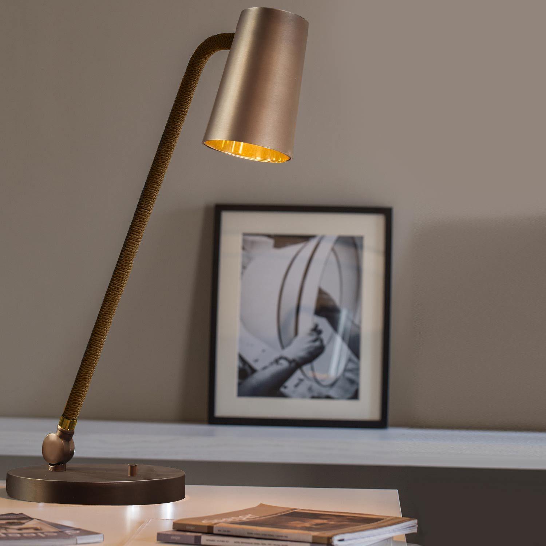 """Lampe bronze de la collection """"Up"""" Elle présente un design"""