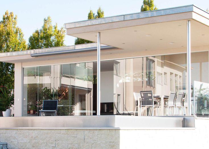 Gartenhaus modern mit Glasschiebesystemen in