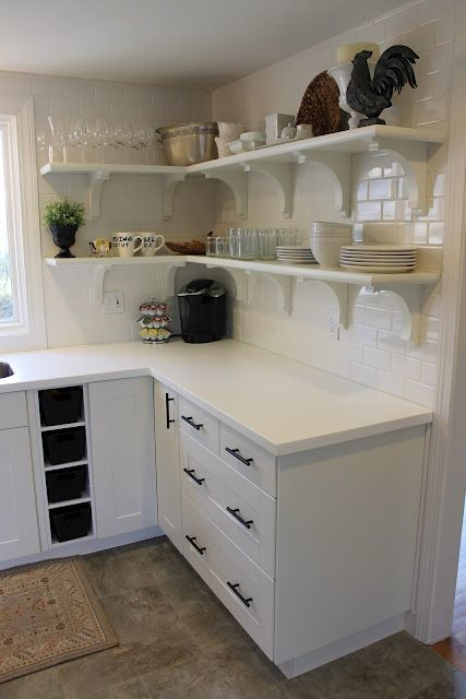 Backsplash: White Subway Tile, Lowes Countertops: White Corian (the Allen/ Lowes