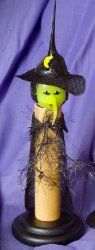 Witch with Cape and Candlestick $24.00.  Inner Bulb Is Replaceable. Item# 01-3000 ($2.00)
