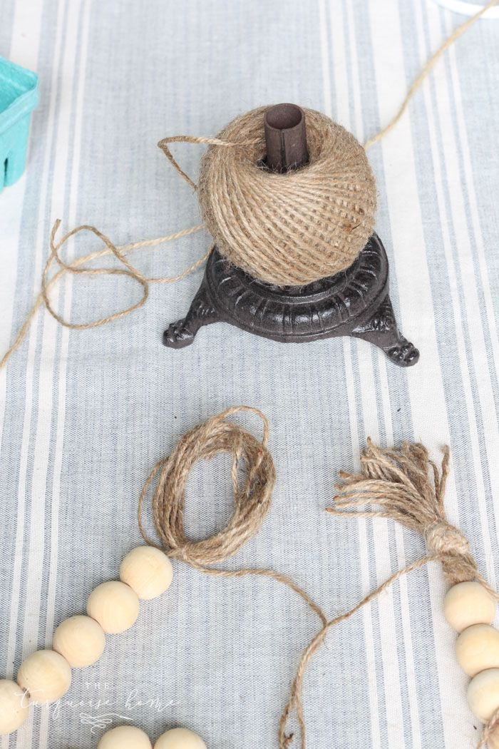 Photo of DIY Wood Bead Garland with Tassels | The Turquoise Home