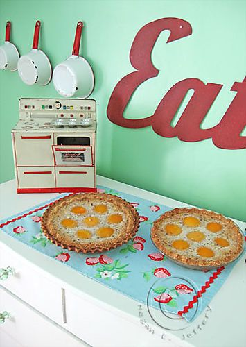 Cute retro kitchen and a peach cream pie recipe very different from my own.