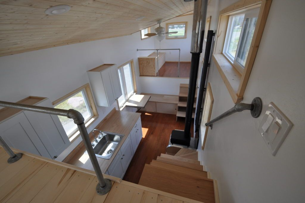 Otsego Gooseneck Tiny House Sleeping Loft Stairs Note Fireplace In Between Two Sets Of Storage