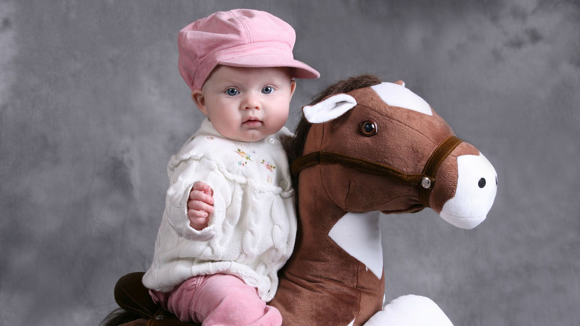 A Cute Baby Riding A Soft Toy Hd Wallpapers 19201080 Allhdwall