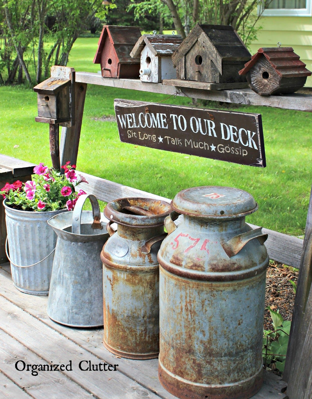 Decorating the deck with Rustic Birdhouses, Old Milk Cans etc .. so ...