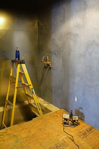 DIY galvanized metal wall and Ardex concrete in the shower