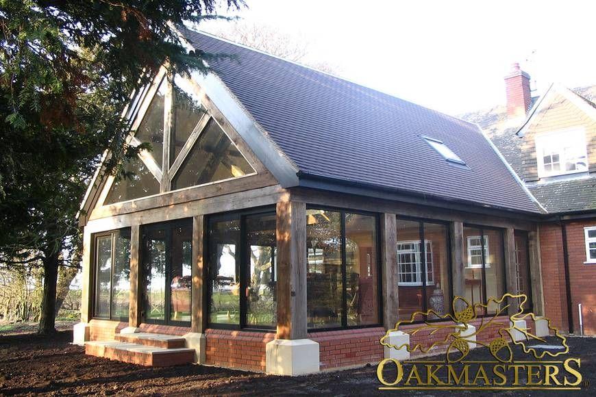 Oak sun rooms orangeries garden rooms and conservatories for Wooden garden rooms extensions