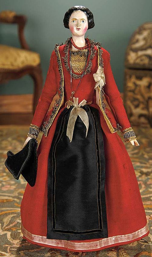 Grodnertal, circa 1840. Rare wooden body with original wooden shoulderhead, original finish, and original well-detailed folklore costume and jewelry.