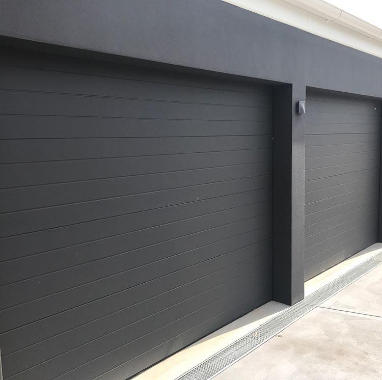 Macquarie Garage Doors On Instagram Danmar Scyon Axon Clad Panel Scyonwalls Is Becoming Garage Door Design Modern Garage Doors Contemporary Garage Doors