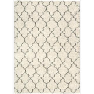 add a pop of pattern to your living room or den with this artfully crafted shag rug showcasing a trellis motif in cream