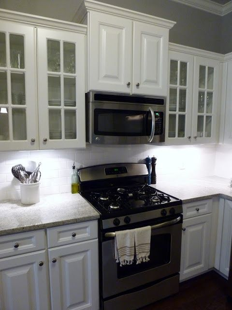 Move cabinet above the stove up to accommodate the above ...