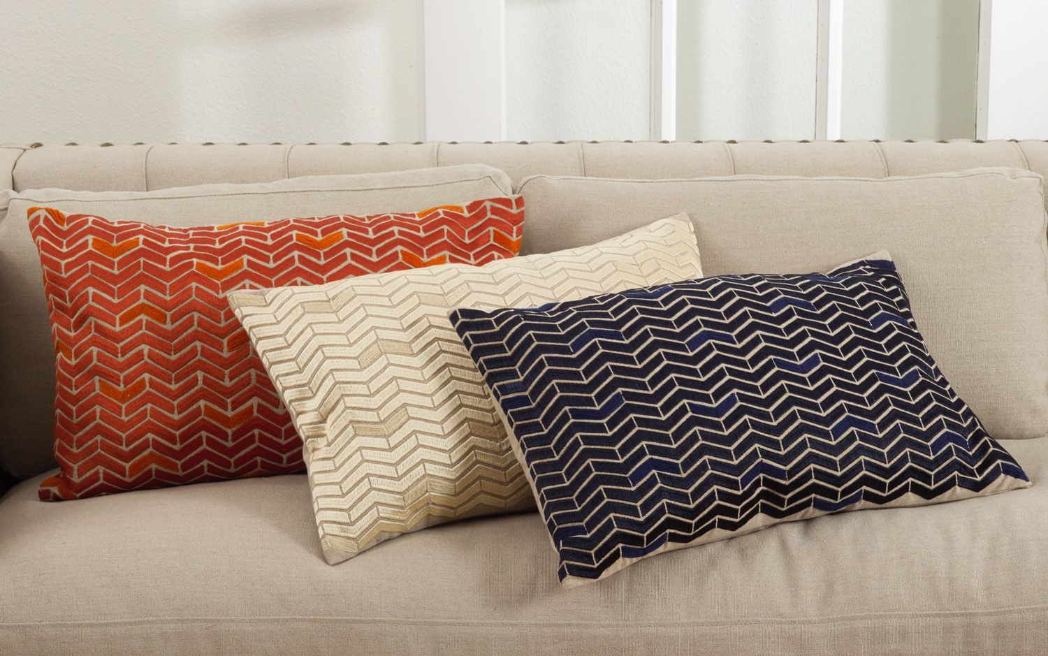 Marcella Design in persimmon, ivory, and navy blue | Pillow Fight ...