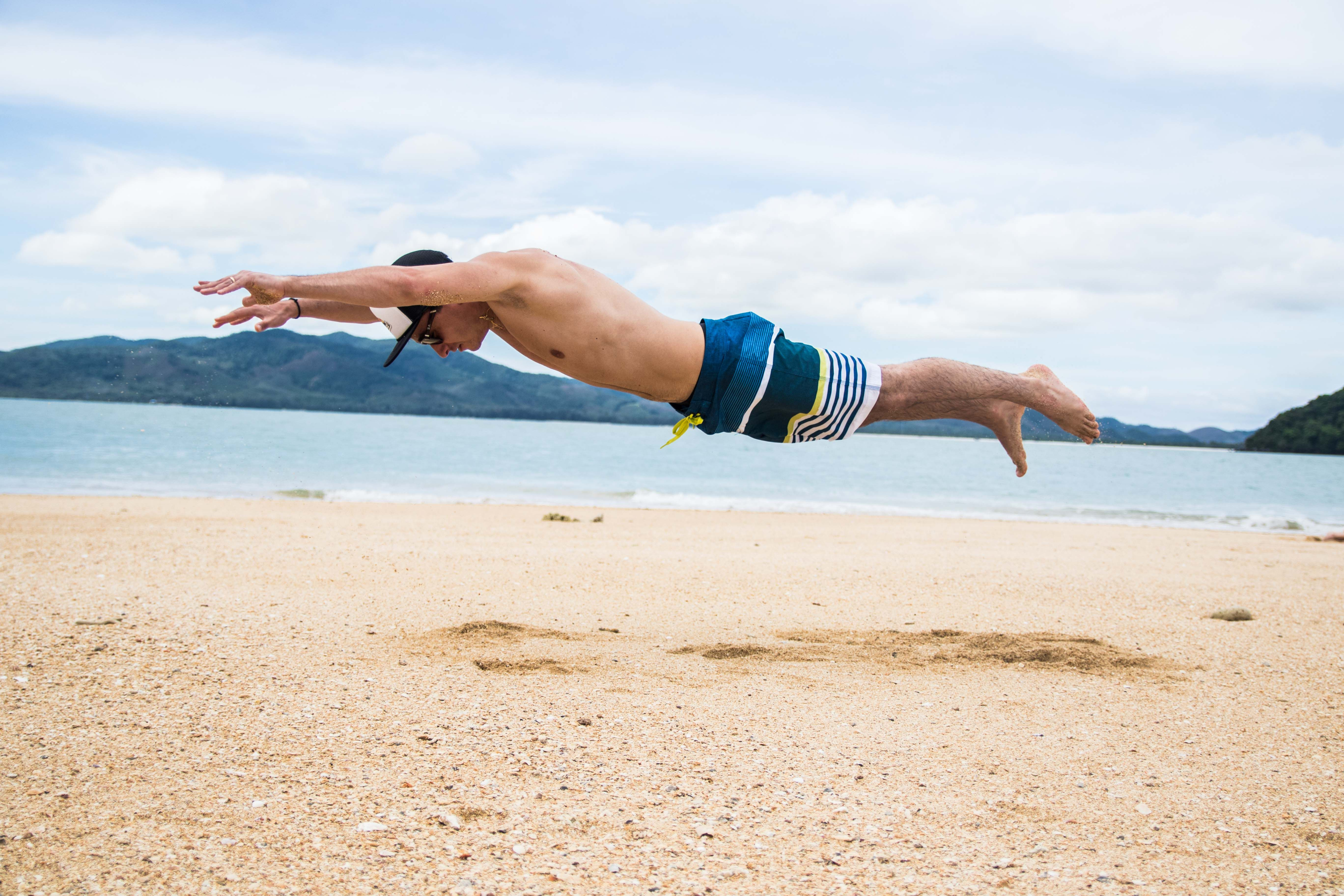 superman flying pushup push up beach