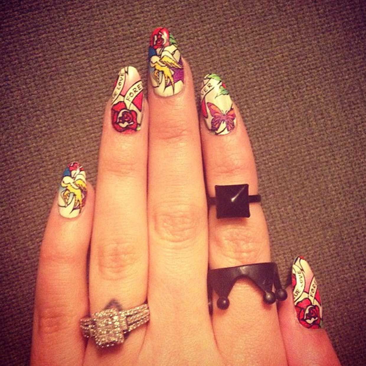 British singer Cher Lloyd put her Sailor Jerry-inspired graphic nails on display for her fans.