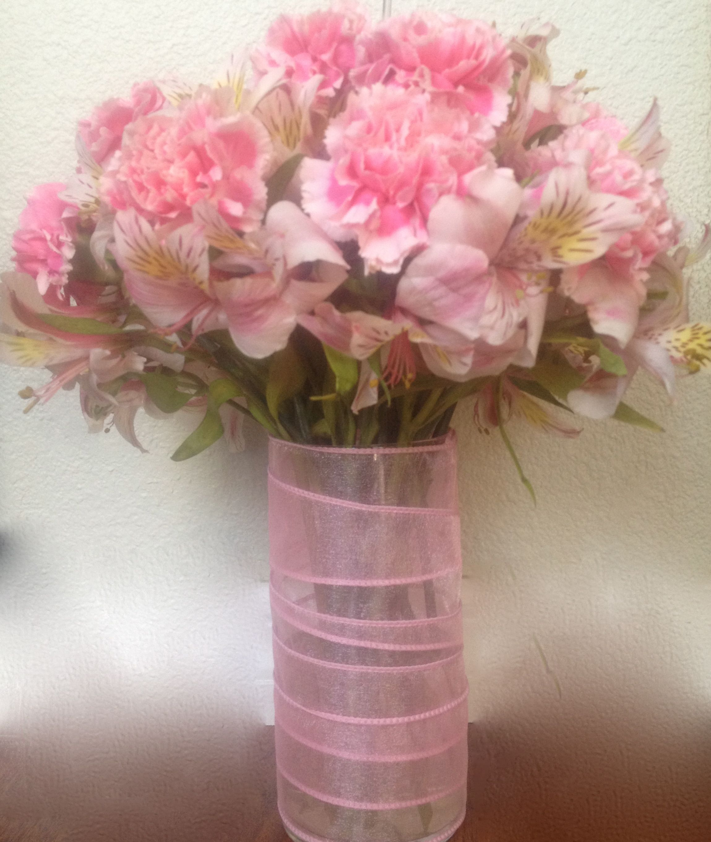 Its a girl pink carnations alstroemeria in a glass vase wrapped its a girl pink carnations alstroemeria in a glass vase wrapped in pink ribbon izmirmasajfo