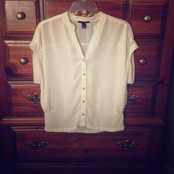 FOREVER 21 - SHORT SLEEVE/BUTTON DOWN BLOUSE Used/Good Condition/Unnoticeable stain on front-- No rips or tears. Off white cream color. Gorgeous paired up with jeans or dress pants!  No Trades  Offers Are Considered Forever 21 Tops Blouses