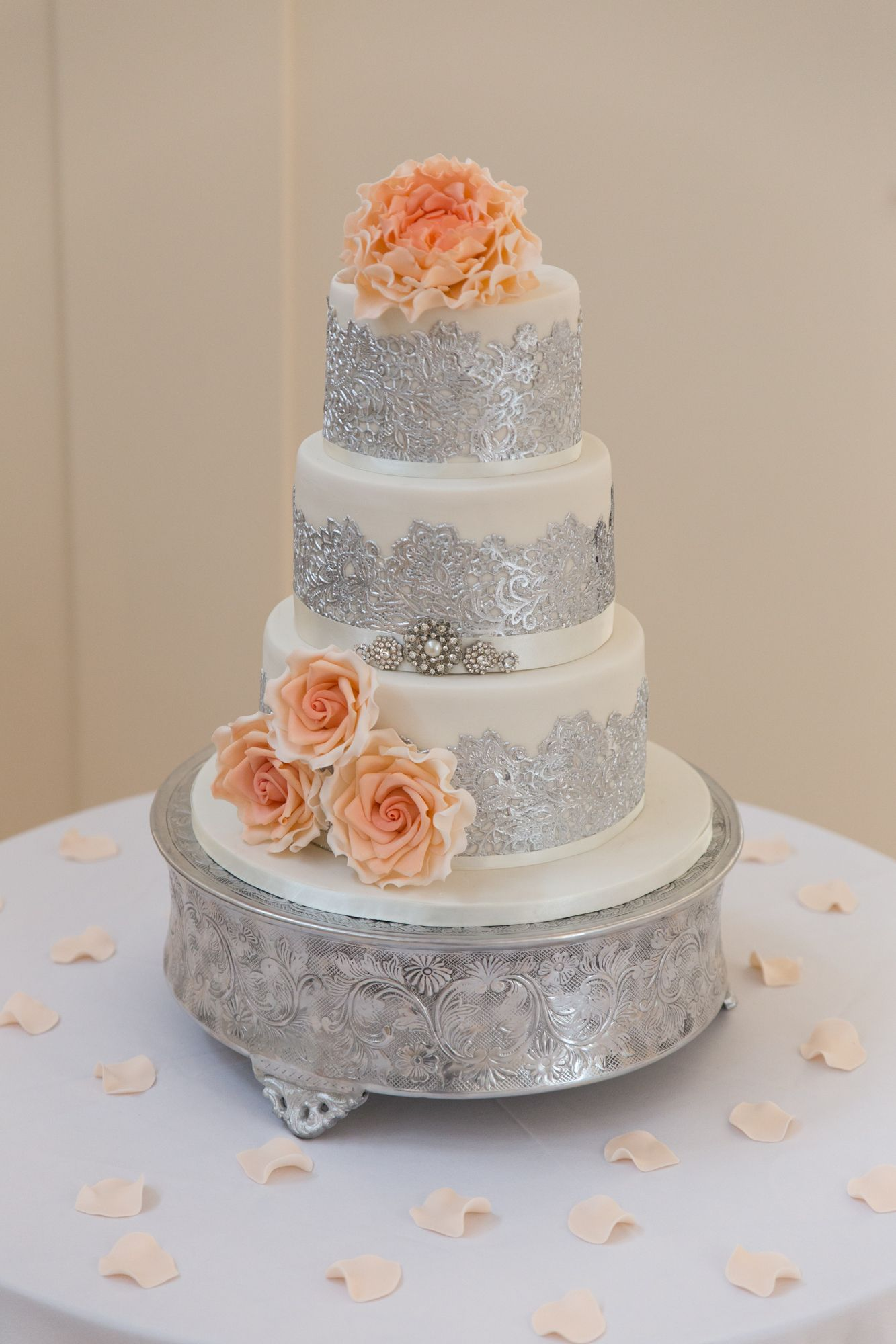Ivory silver lace and coral and peach ombre flowers