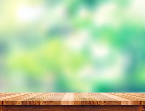 Empty Plank Brown Wood Table Top With Blur Green Tree