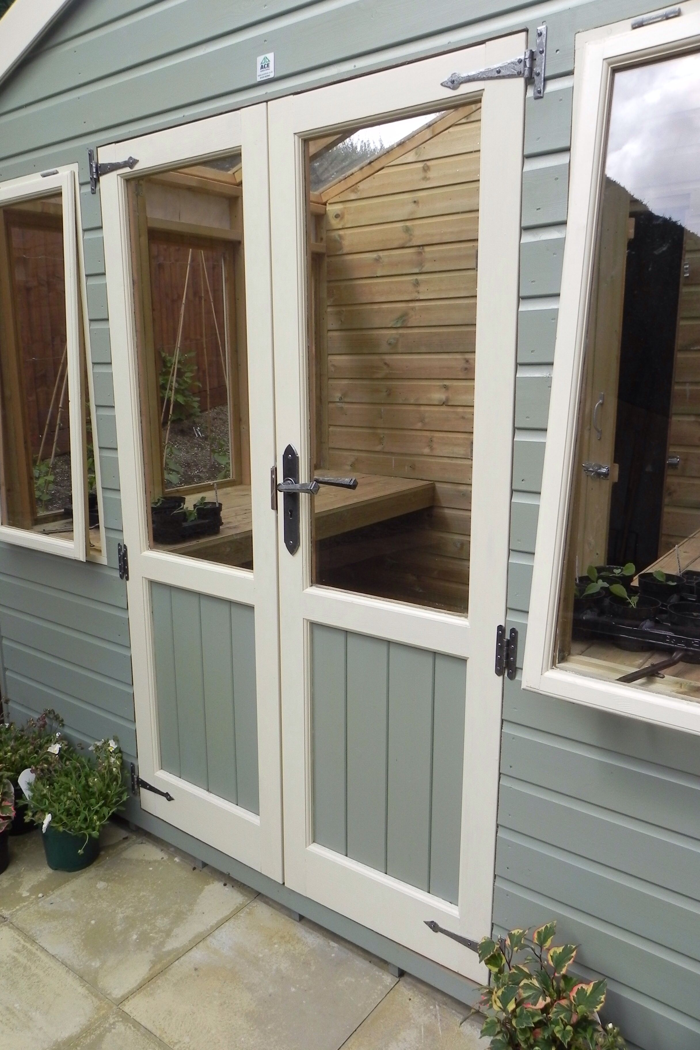 potting shed painted with ronseal colours, manufacturedace