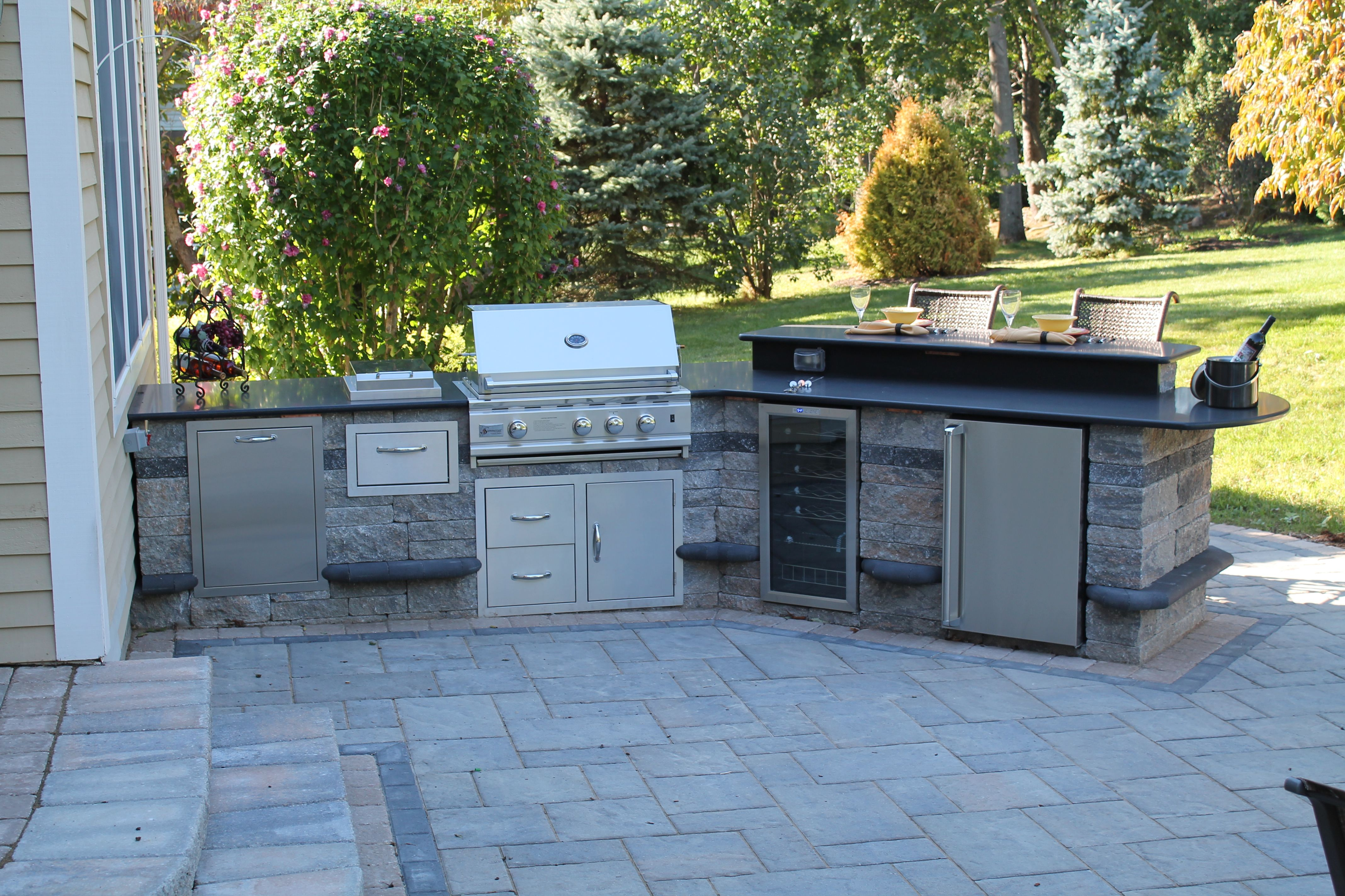 Built-in outdoor kitchen w. grill, trash can, paper towel holder ...
