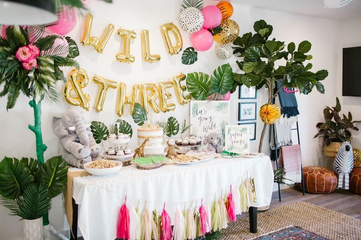 These Nurseries Take You to a Tropical Paradise Every Day #tropicalbirthdayparty Young Wild and Three birthday party decorations #kidsbirthdayparty #kidsbirthdaypartyideas #girlbirthdayparty #girlbirthdaypartyideas #boybirthdayparty #boybirthdaypartyideas #tropicalbirthdayparty