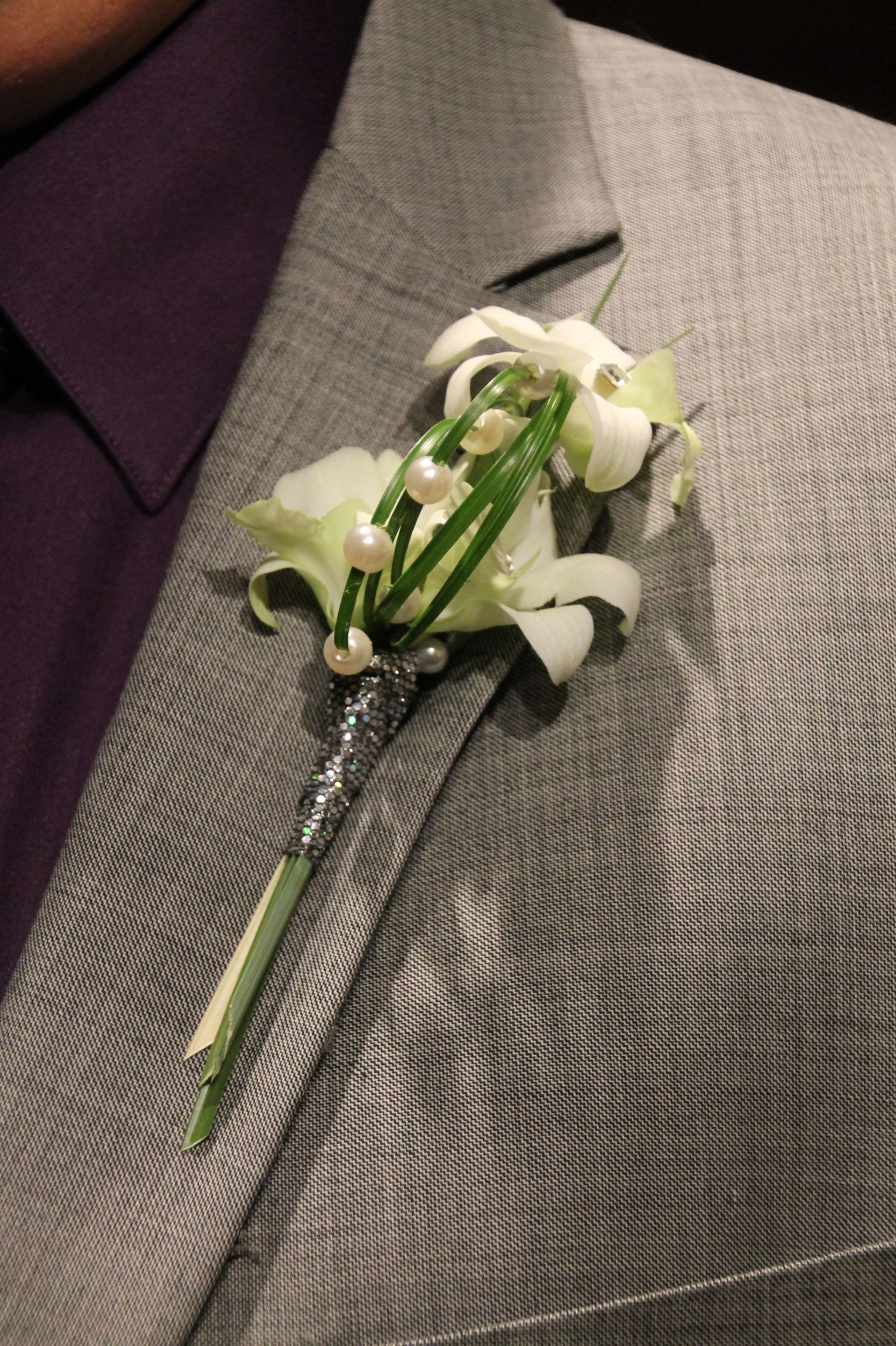 White Flower Boutonniere With Bear Grass Created By Judith Marie