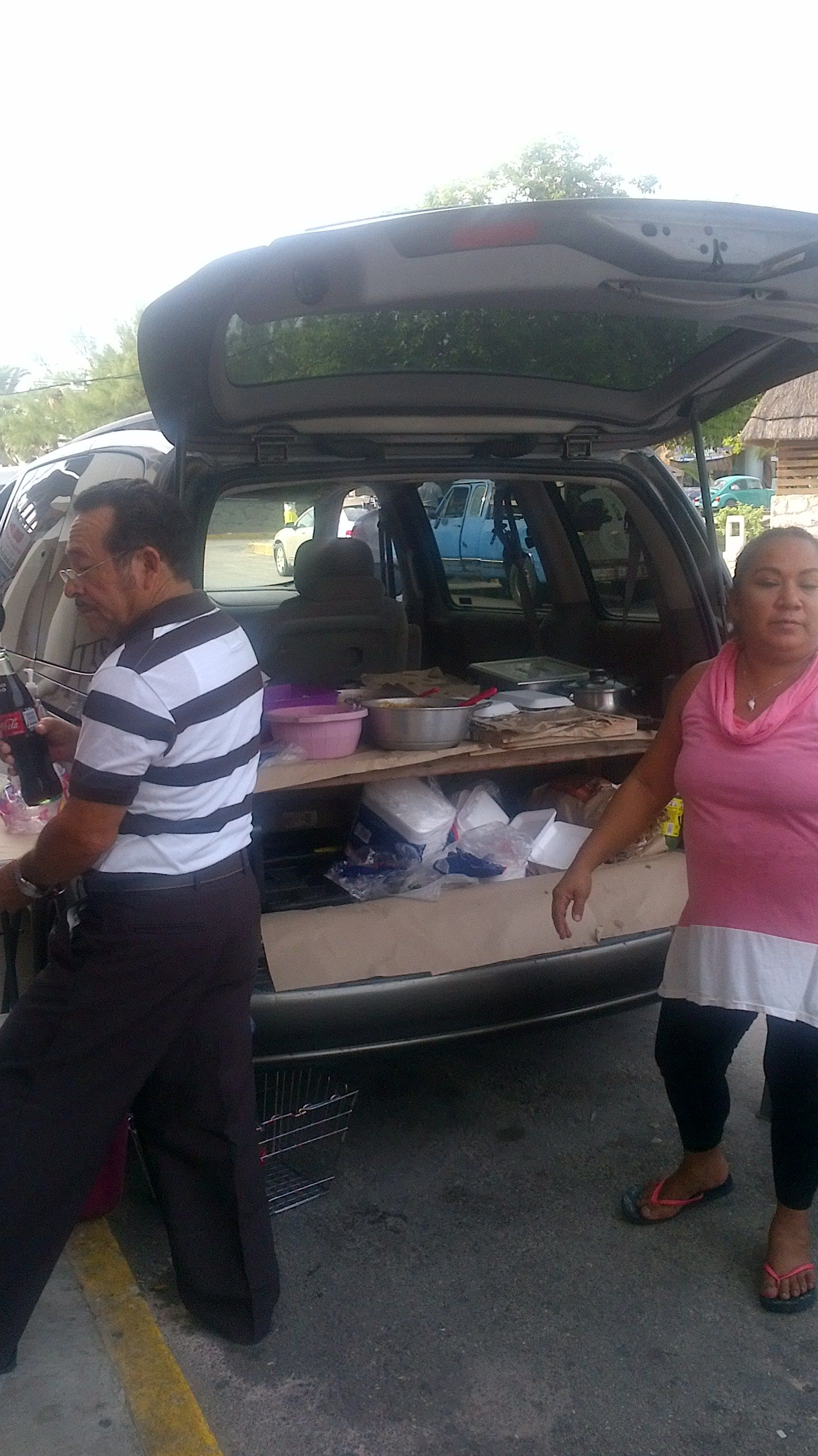 Fishermans breakfast out of back of van - Puerto Morelos town square