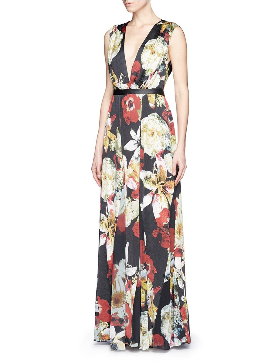 Detailed with a deep vneckline and a back cutout this romantic