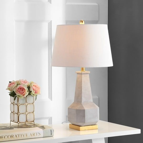 Add a soft, warm glow to any space with this faceted table lamp in a perfect shade of cloud gray. With a geometric cement base and simple white lampshade, this modern table lamp is the perfect mix of function and style. Whether on a living room end table or in your study, you'll love the unique touch this piece brings to your decor.