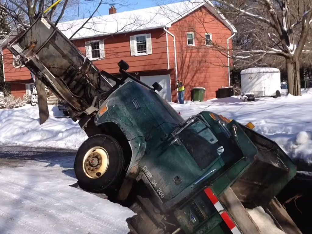 Winter Bites: Sinkhole Swallows Innocent Snowplow http://www.people.com/article/sinkhole-swallows-snowplow