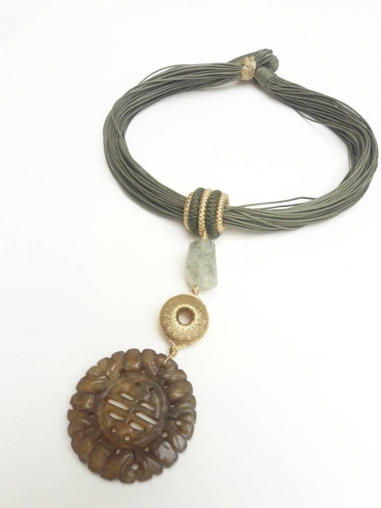Vintage carved brown jade pendant on green multistrand silk rope