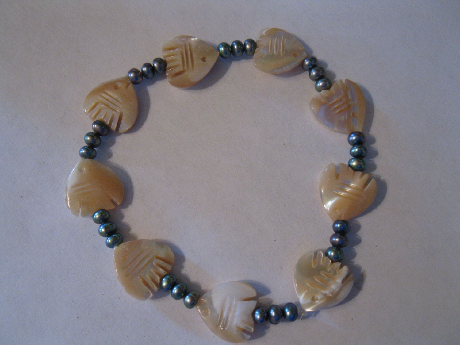 Bracelet: Mother of Pearl fish with pearls. $20.00, via Etsy.