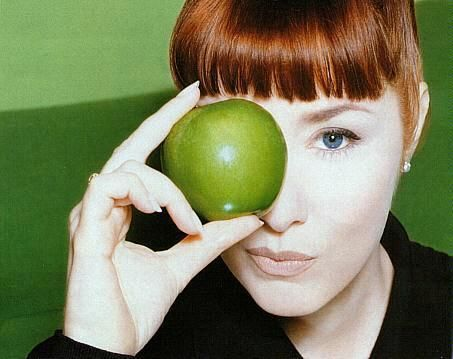 Suzanne Vega.  I fell in love with her songs at age 16.