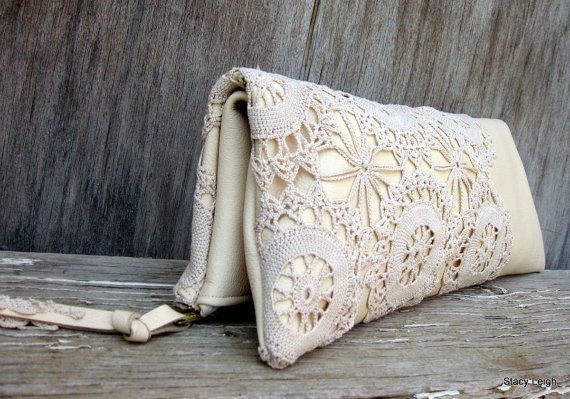 Soft creamy ivory leather in a simple zip top clutch. The front has vintage crocheted lace for a tone on tone, leather / lace bag. Top brass zipper. Leather / lace zipper pull. Bag is 13.5 by 10.5. One of a kind. Use full size or double over for a more slender bag. Unlined, suede side of the leather inside.