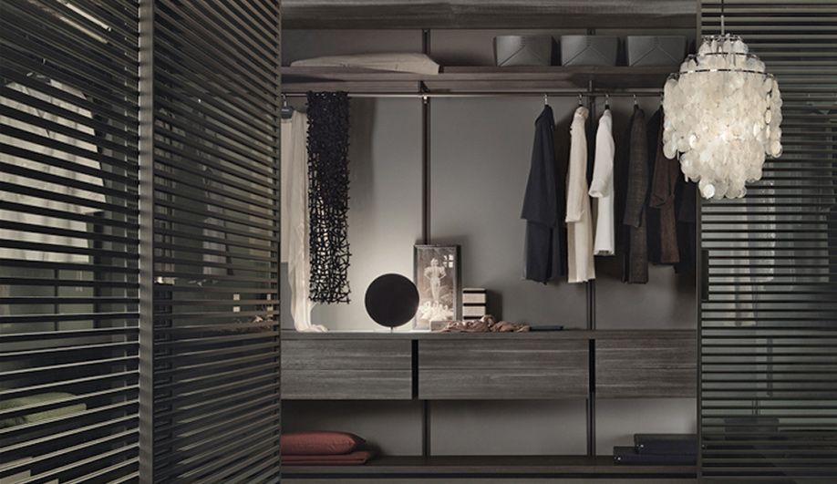 Slatted doors define Rimadesio's Dress Bold wardrobe, with shelves, floor units and wall panels made of melamine-finished larch wood treated with a coal stain   azuremagazine.com