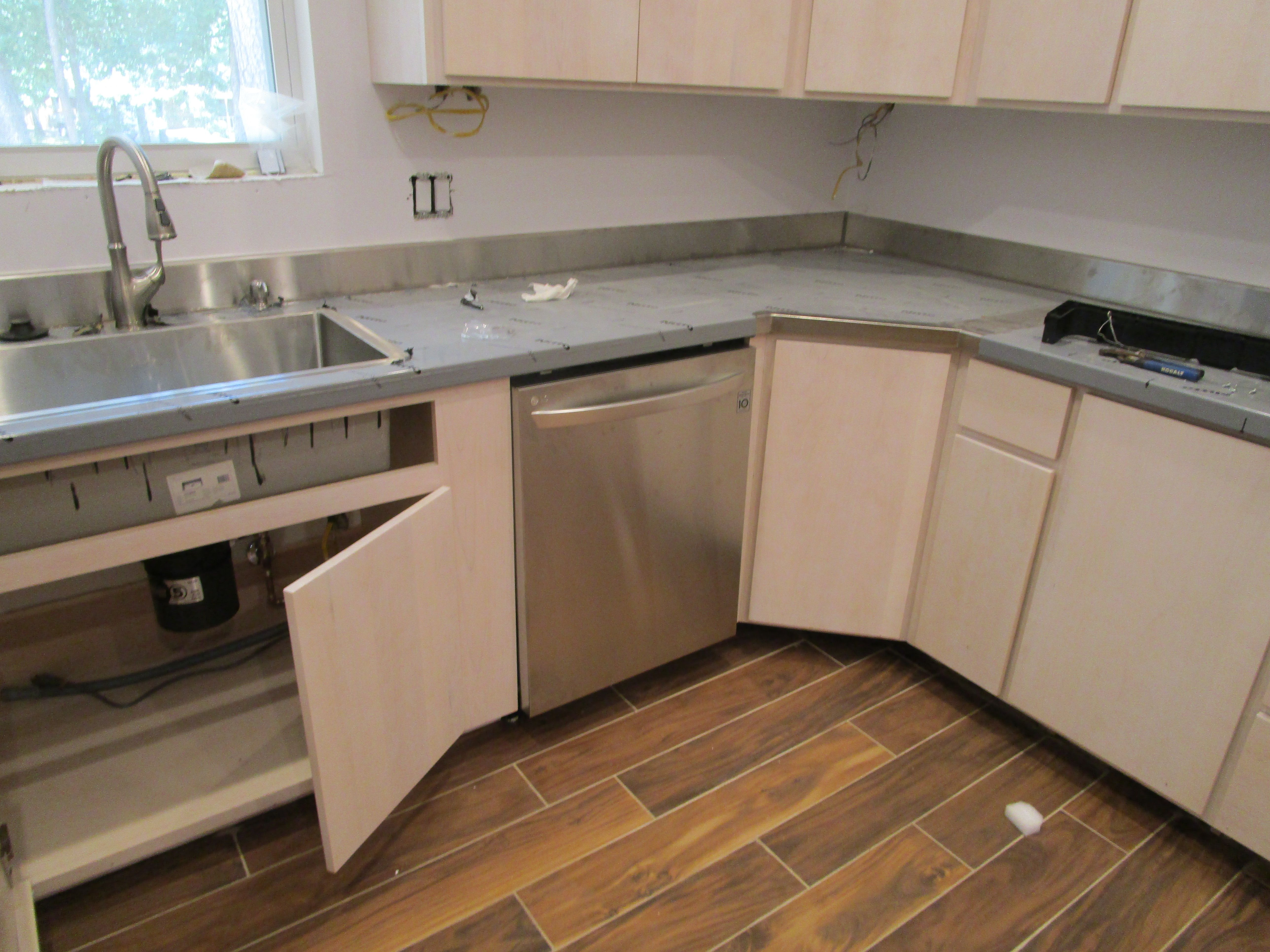 The dishwasher is installed and awaiting the electrician ...