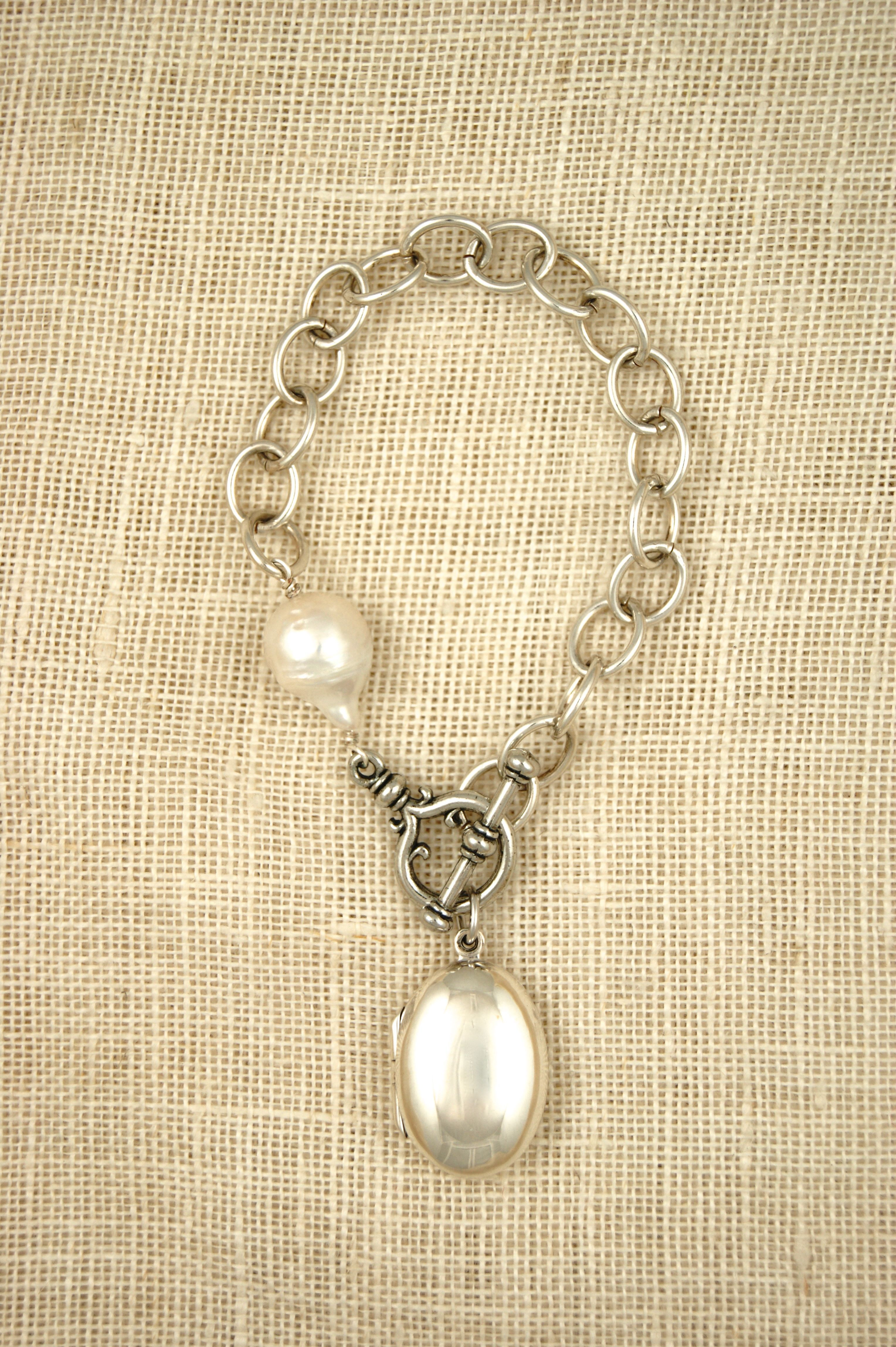 Sterling link bracelet with pearl and sterling locket by ExVoto Vintage Jewelry.