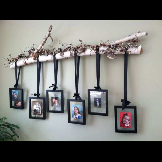 Use Tree Branches To Hold Pictures In 2019 Tree Branch Decor Branch Decor Diy Home Decor