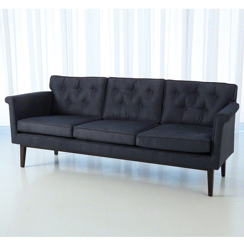 Inspired by the petite frames of the 50's this sofa features