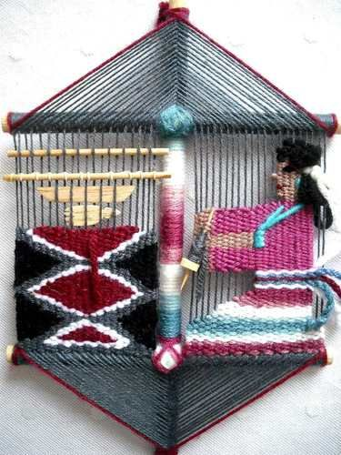 A mixture of a God's Eye and tapestry weaving--interesting idea!