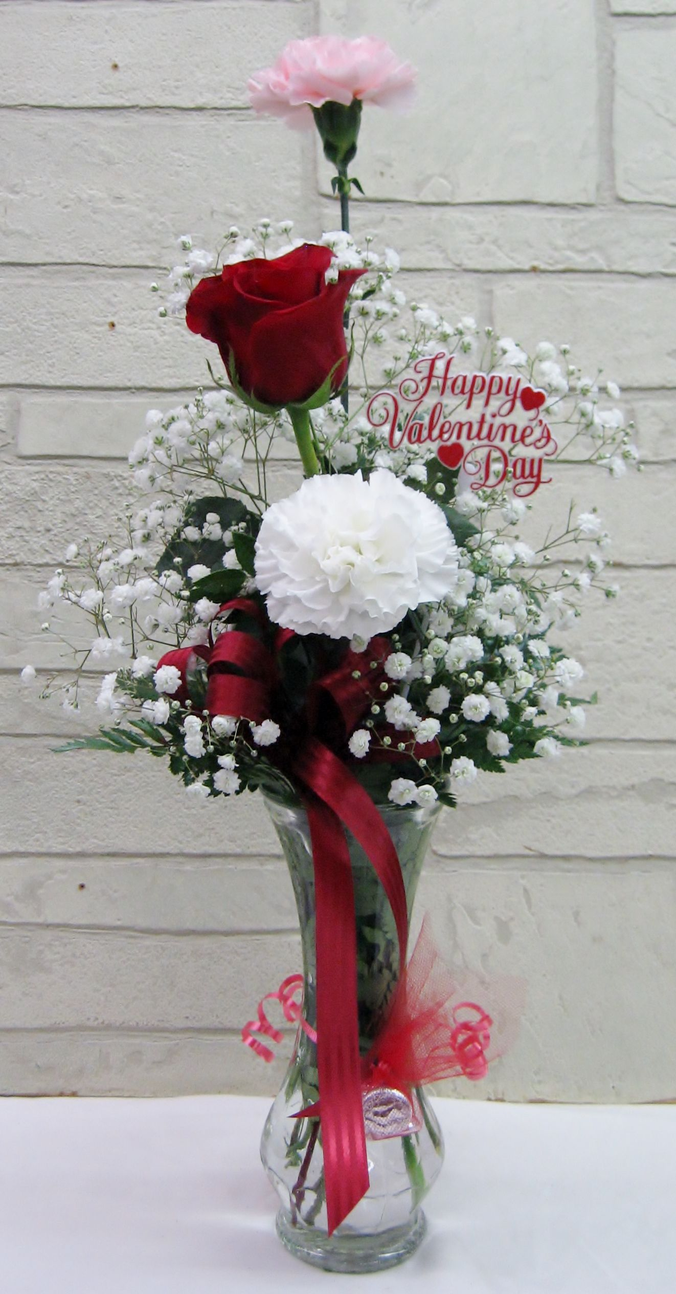Two assorted color carnations and a red rose in a clear glass bud two assorted color carnations and a red rose in a clear glass bud vase with hershey reviewsmspy