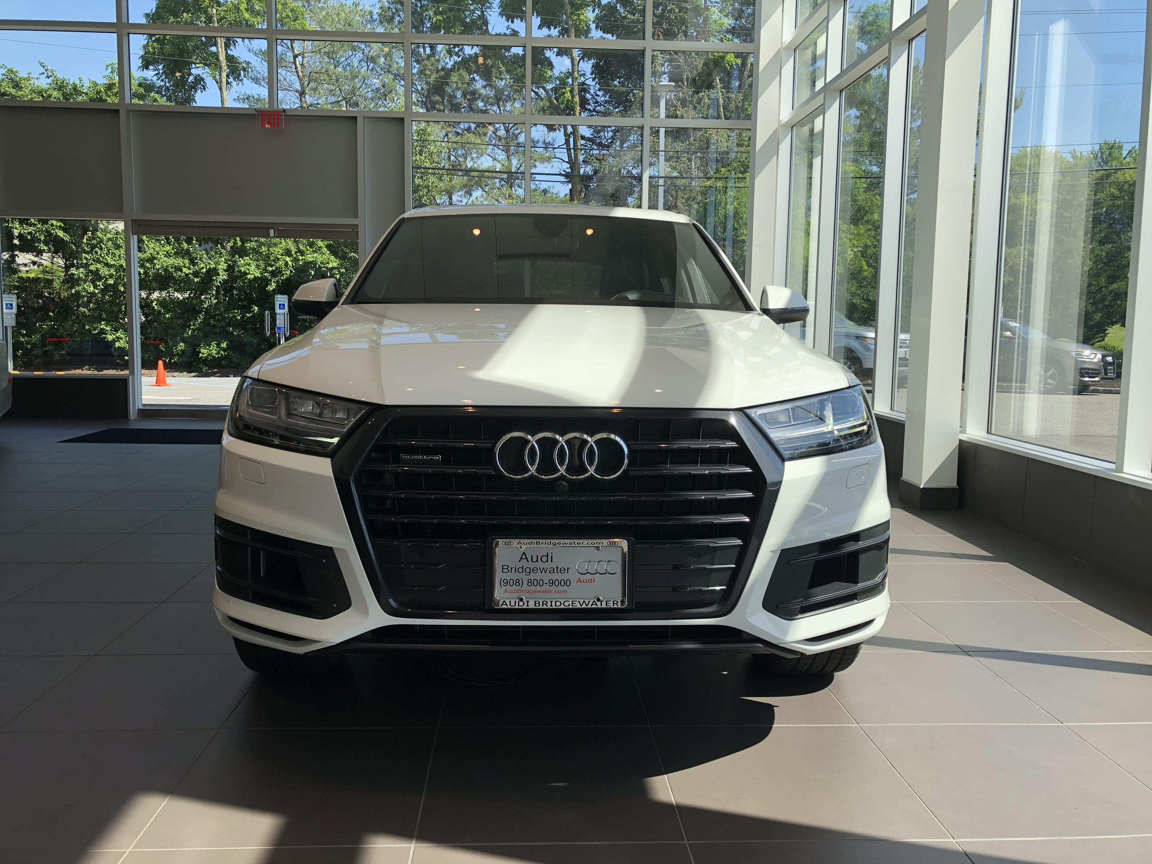2018 Audi Q7 In Carrara White Front View Of Grill And Headlights Vehicle Available At Audi Of Bridgewater Nj Audi Dealership Audi Used Luxury Cars