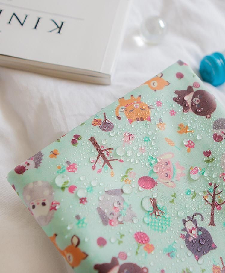 Laminated Cotton Fabric Candy Animals In Mint By The Yard 92576 Laminated Cotton Fabric Cotton Fabric Fabric