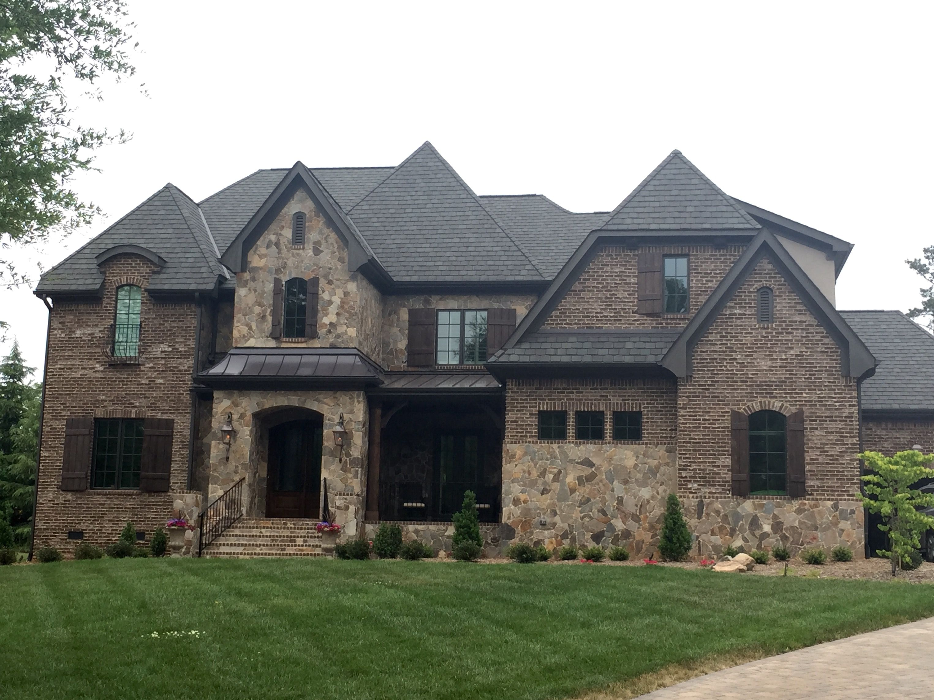 Arh silveroak plan exterior 39 stone chocolate gray for Metal roof pictures brick house