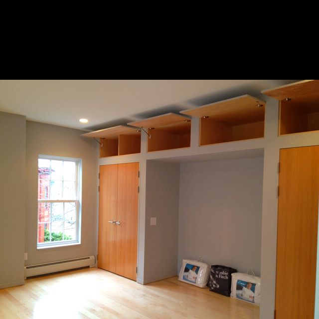 High Ceiling Storage And Alcove For Bed