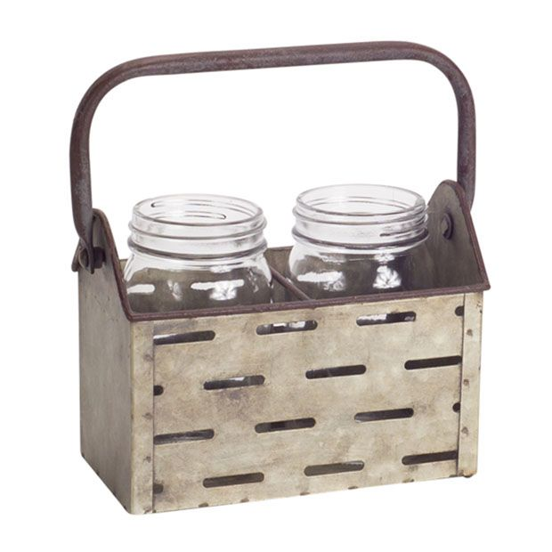 Use our 2 Jar Rustic Metal Caddy to store paintbrushes or kitchen utensils. This set of canning jars in their metal container will also look lovely holding wildflowers or herbs on a windowsill or countertop. You can use this storage container in the washroom on a console table or even on a bookshelf in your study.