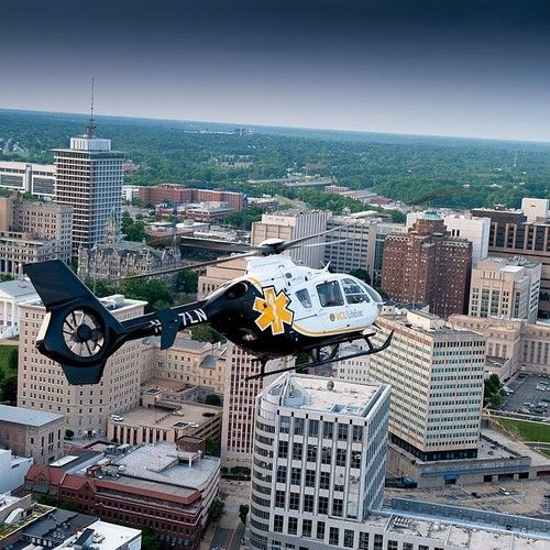 A helicopter from VCU Medical Center's nationally accredited LifeEvac program flies over Richmond.  – Photo by Allen Jones, VCU University Marketing